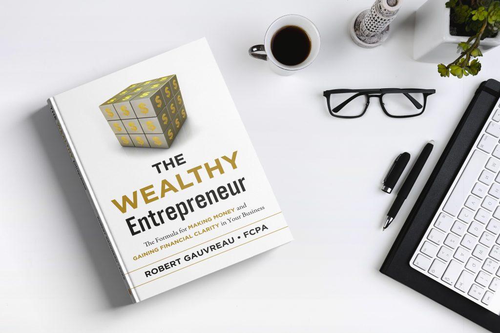 The Wealthy Entrepreneur Book on desk