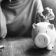 Putting money into a personal piggy bank